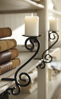 Candle holders that attach to shelves - great idea!