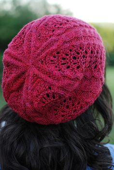 Knitted slouchy hat with cables and lace