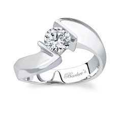 Round Solitaire Engagement Ring - 3748LW - One of our vast collection of solitaire diamond engagement rings this channel set round diamond ring has cathedral shoulders that twist and rise to capture the center with bold styling and a contemporary look. This ring would also work well with princess cut diamonds.  Also available in yellow gold, 18k and Platinum.