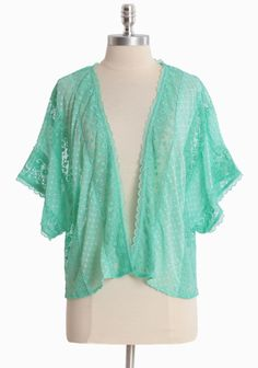 "Peppermint Delights Cardigan 42.99 at shopruche.com. Delicately textured panels of ethereal chiffon give way to demure floral lace on this romantic mint cardigan. Polished with dolman sleeves, dainty lace accents, and feminine scalloped hems. Sheer.Shell: 100% Polyester, Shell 2: 100% Cotton, Imported, 22"" length from top of shoulders"