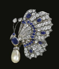 I like the wings of this late 19th century natural pearl, sapphire and diamond butterfly brooch. Not too sure about the body.