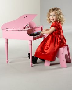 Mini Grand Piano, Pink by MELISSA & DOUG at Neiman Marcus. My baby wants this for her birthday :)