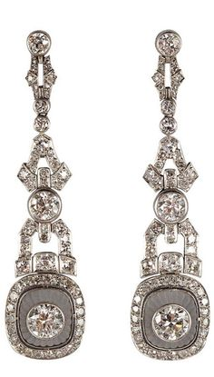 Amazing Art Deco Rock Crystal Diamond Platinum Earrings, circa 1935.  Each earring centers 1 bezel-set transitional-cut diamond within a fluted dome of rock crystal surrounded by bead-set single-cut diamonds, suspended from a flexible column composed of geometric shapes set with old European-cut, rose-cut and single-cut diamonds.