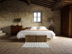 Mmm, Tuscan. Love the exposed beams and stone work, clean lines, symmetry...