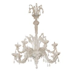 Ornate clear Murano glass twelve arm chandelier with hand blown flower and teardrop elements.