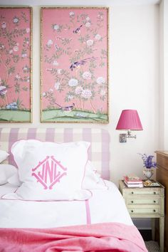 framed fabric panels above bed, large check headboard, pink lamp shade, pink bedside wall sconce, monogrammed pillow cases, French style bedroom with pink and green accents, framed wallpaper above bed