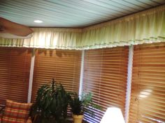 Sun porch valence. Gathered soft butter colored fabric with lime ribbon for trim.