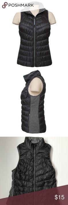 """Gray Insulated Vest size XXL Great used condition, only flaw is that interior letters came off (see photos)  A lightweight down vest, Unique shirring, Center front zip with zipper garage  Two front full size zip pockets, High low hem  Quilted front and back, from a smoke free home. Solid color accents at neck and yoke and heather knit side panels. measures 21.5"""" from underarm to underarm and 27"""" in length from back collar Tangerine Jackets & Coats Vests"""