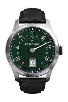 Does an excellent job of reminding me of one of my first cars. The Mini, and it's in my favorite colour too.  Jump hour, retrograde and a fuel gauge for the power reserve.  Nicely done.