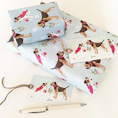 Deck the halls wrapping paper featuring a cute Border Terrier and Jack Russell http://www.notonthehighstreet.com/siroccodesign/product/border-terrier-and-jack-russell-wrapping-paper-pack