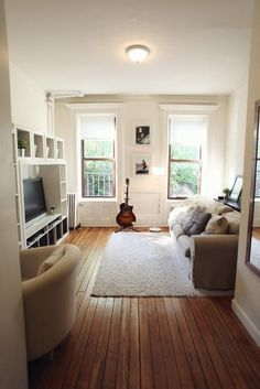 525 hudson street rental in west village, manhattan | small nyc apartment, white walls, exposed brick painted white, living room