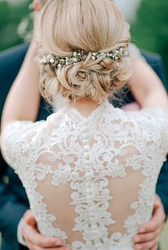 sophisticated lace wedding dress and updo wedding hairstyle perfect match
