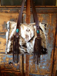 "Customized cowhide Buckaroo Tote with diaper bag lining. 16"" wide, 12"" high and…"