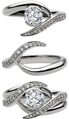 Entwined Bridal Set: Engagement Ring & Matching Wedding Ring..that's kinda cool! Wonder if it comes in yellow gold