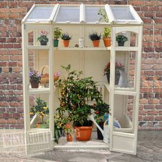 The Hartwood Victorian Tall Wall Greenhouse is flexible and compact. The Greenhouse includes two heights of shelving and the middle shelves can be adjusted to accommodate any taller plants. The greenhouse has two opening vents suitable for use with aut