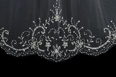 New to our handmade collection - Beautiful handmade beaded edge veil with slightly scattered swarovski crystals.  fingertip length 36 long x 72 wide on a metal comb  Made to order please allow 7 days to ship.  also available in elbow length a bit shorter price the same.  available in white, diamond white/off white or ivory.