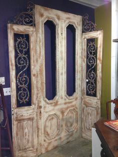 Old door repurposed into a decorative room divider!