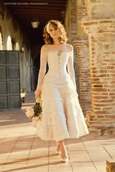Corseted wedding dress.... I'd wear this.