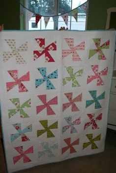Pinwheel quilt - what a cute color scheme and pinwheel!