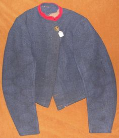 FIG 5: Another front view depicts the machine stitching along the button lapel.  The scarlet collar facing has been added to what a plain variant Tait jacket.  The Virginia button may indicate that a Virginia soldier originally wore the jacket.  Images courtesy of History Colorado, Francis Marion Durham Collection, Photo. #2005.52.3.v2.