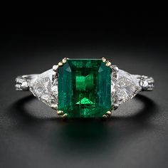 This deco cut is so pretty, and I like emeralds.