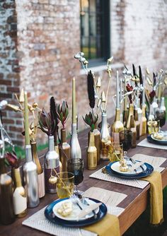 20 Gorgeous Holiday Decor Ideas | Holiday decorations for Christmas 2016 - gold + silver DIY wine bottle centerpieces