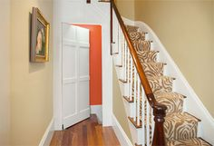 Create a hidden passage disguised as a paneled accent wall by trimming out a slab door with poplar boards