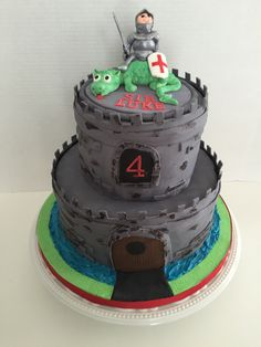 cakesbykirsten  Caslle cake with green dragon and knight.  #castlecake #dragonknightcake
