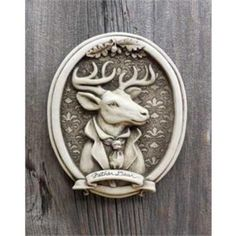 """Father Dear - """"First in the Distinguished Beast series, a whimsical deer, with a family portrait feel. Note the detail on this handsome fellow, down to the fancy cravat and wallpaper behind him. What a fun design!  Image is Aged, other options are Natural, Green, Terra Cotta and Designer White   Dimensions: 8.75 x 7.25 x 1.75 Composition: hand cast stone"""""""