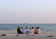 Men Meeting On The Beach, Salalah, Oman