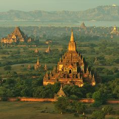 """Bagan Temples in Bagan, Burma."" -- or alternately, ""Pagan Temples in Myanmar,"" but the names are mixed; Pagan and Burma are the old names.  Between the 11th and 13th centuries, there were over 10,000 Buddhist stupas and temples on this plain...now ""only"" 2200 survive. More info and astonishing photos here: http://en.wikipedia.org/wiki/Bagan"