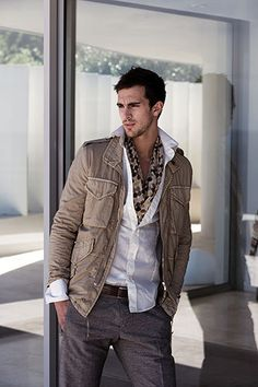 Cool scarf accent with white shirt and safari jacket.