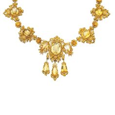 GOLD AND CITRINE NECKLACE, 1830S Of floral repoussé and cannetille work design, set with oval and pear-shaped citrines, length approximately 490mm.