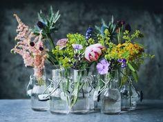 Pretty flowers in bottles.