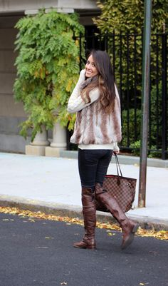 Fall style: faux fur vest, louis vuitton neverfull tote bag, over the knee leather boots