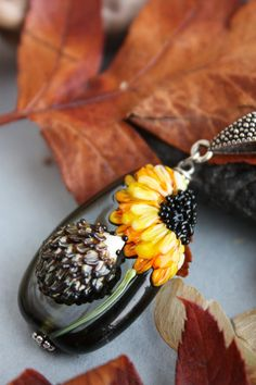 Glass lampwork pendant with hedgehog and by TaigaLampwork on Etsy