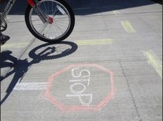 How to make driveway bike riding more fun: Great bike safety practice ideas using little more than sidewalk chalk.
