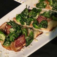 California Pizza Kitchen is serving up items from their new menu at Yelp OC's 3rd annual Monster Mash/ball like this flat bread with Brussels sprouts & bacon #newcpk #yelpmonstermash