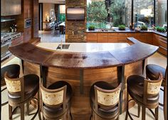 big kitchen island with work area and rounded bar seating