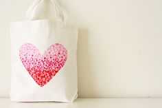 V and Co: how to: painted heart bag (a totally great + simple idea for stamping w/ pencils inside a stencil of freezer paper)