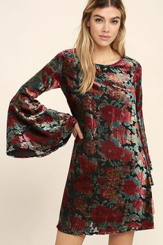 The Elektra Black Velvet Floral Print Dress is everyone's new party favorite! A unique, burnout velvet floral print in shades of red, brown and green and sheer woven fabric shape a rounded neckline and long, bell sleeves. Shift silhouette. Hidden back zipper.
