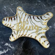 Check out this item in my Etsy shop https://www.etsy.com/listing/492535186/gold-and-white-zebra-ring-dish-bling