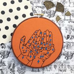 A pair of hands with stars are embroidered by me with 100% cotton pumpkin orange fabric and black embroidery floss into a 6 wooden embroidery hoop. The stars are painted with acrylic paint and then stitched with blue embroidery floss. The fabric is glued to the back of the hoop to ensure a long-lasting piece of art.  Need an item personalized? The possibilities are endless! I also do complete custom orders (just click on the request custom order button on my shops main page.) I love pushing…