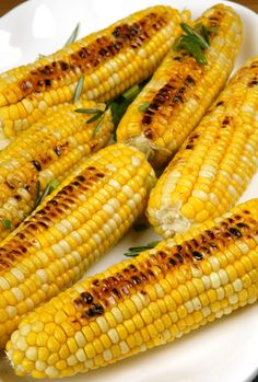 Grilled Corn With Sriracha Scallion Butter from 7 Sriracha Recipes   E! Online
