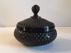 We simply adore this gorgeous black milk glass hobnail container. Milk glass in any color is superb, but if you ask us, the black milk glass has a certain je ne sais quoi. Perfect on a nightstand, desk, or bookshelf, this is once of those pieces that is small but really makes a statement.
