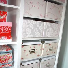Boxes covered in wallpaper samples.