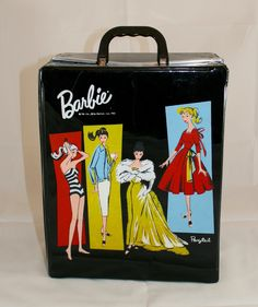 Original 1961 black Barbie carrying case including original cardboard drawers which are in excellent condition. 6 Hangers are inside along with 3 cardboard drawers and the snap strap to hold Barbie se