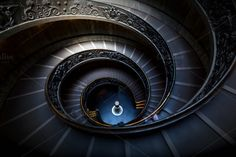 Long spiral, winding stairs. ~ Architecture Photos on Creative Market