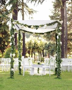 A unity candle—beneath a chuppah hung with ruscus leaves, ivy, hydrangeas, peonies, and roses—joined Maria and Jordan's Catholic and Jewish faiths during their wedding ceremony in Rome.