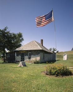 Dowse Sod House, Comstock, Nebraska. In 1900, homesteader William Ryan Dowse sliced long, deep strips of sod and stacked them — grass-side down — in rows that became the walls of his prairie home. Scarce wooden boards were laid across them to form joists and the outline of an attic. More sod was arranged atop the roof paper, and openings were cut for windows and doors. Walls were plastered with a mix of sand, clay, and hog's hair. Photographer Carol M. Highsmith's America, Library of…